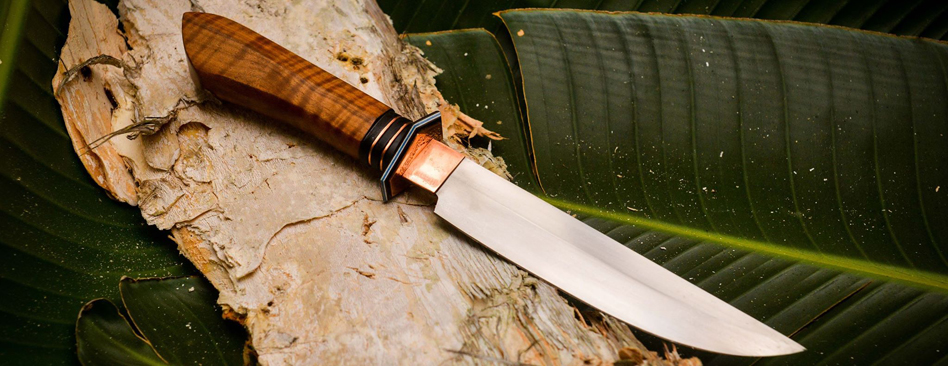 stainless fillet knife with added copper highlights, budgeroo burl handle